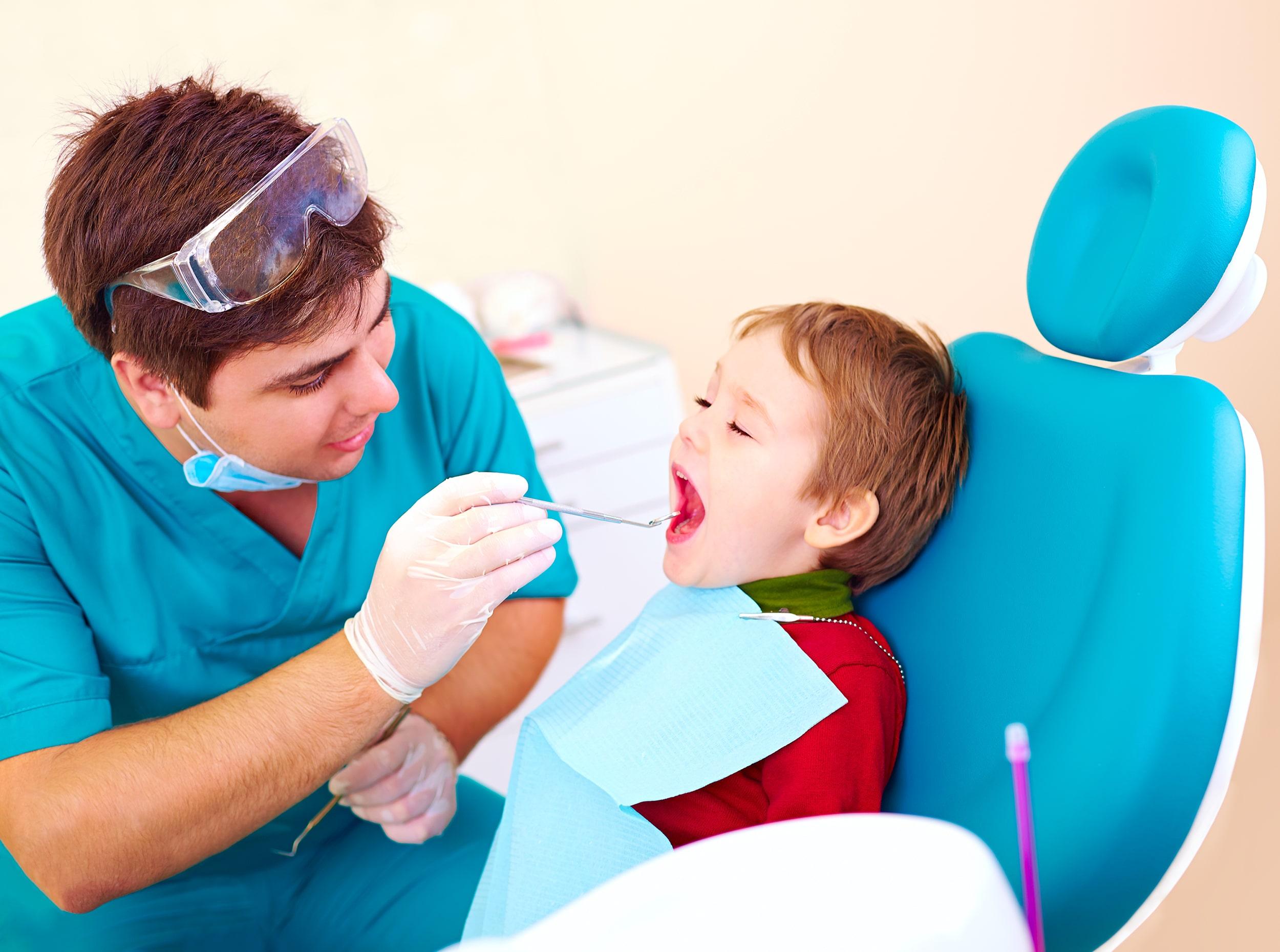 Child getting a dental exam