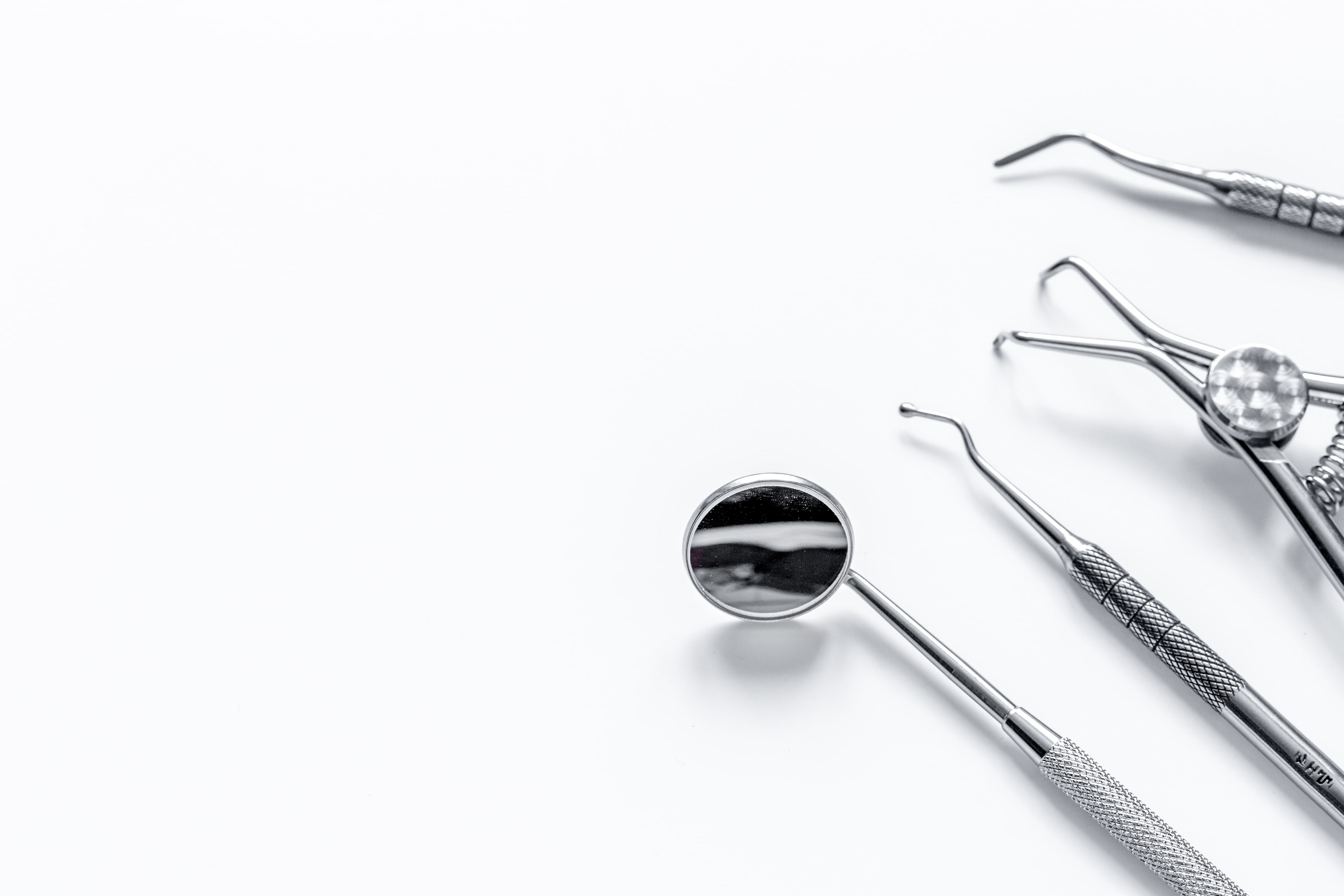 Various dental tools on a white background