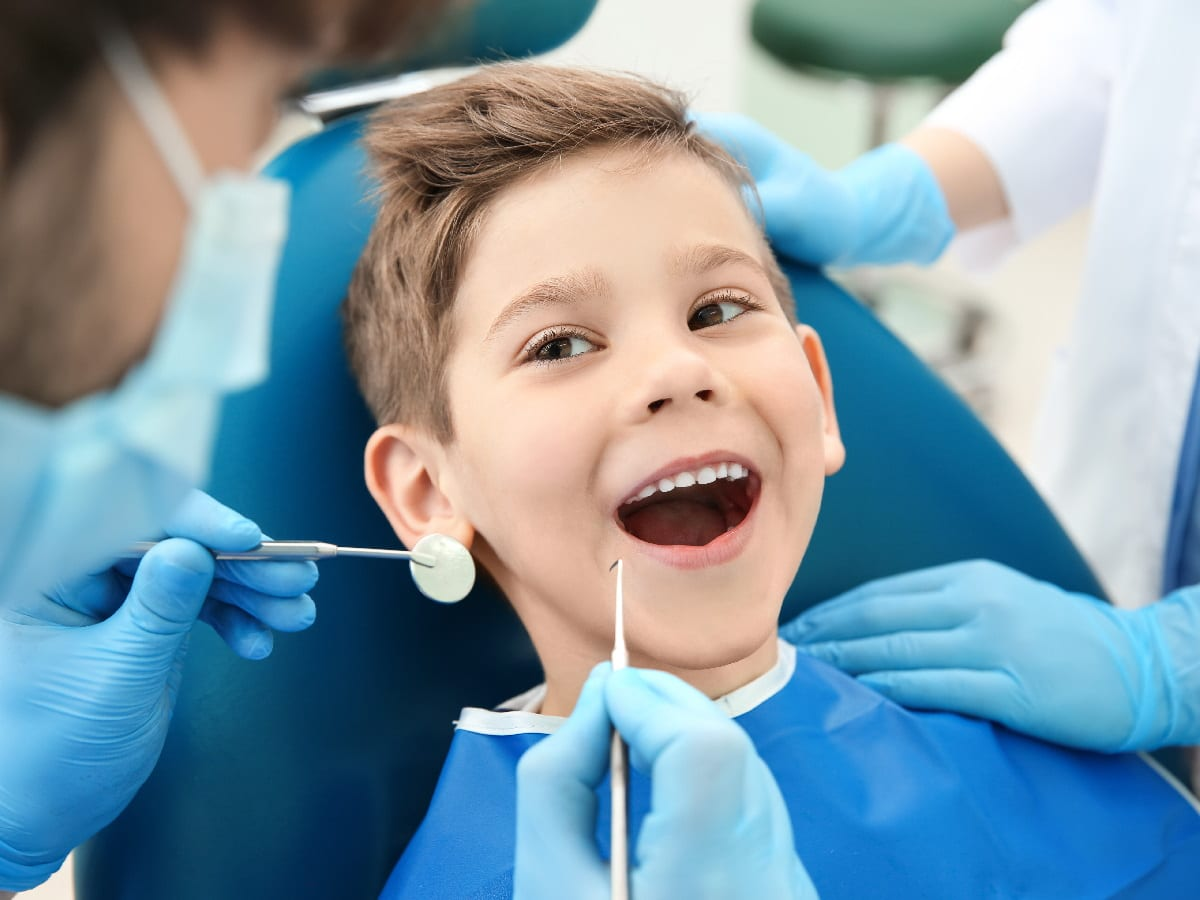 Smiling Kid At Dentist