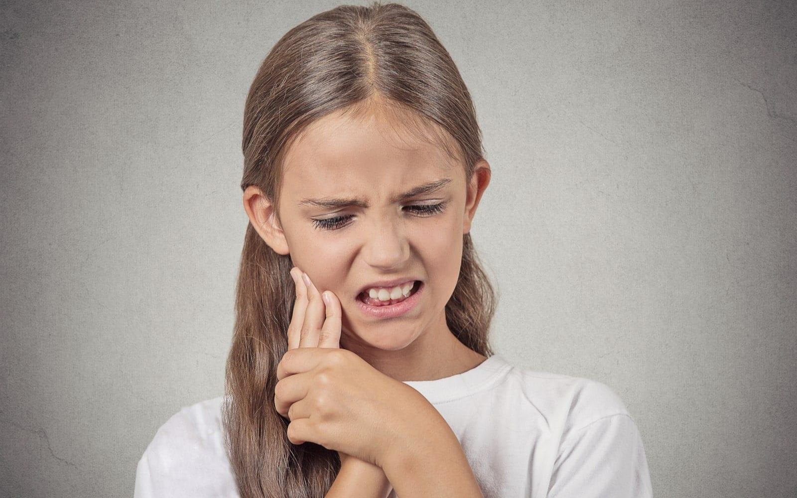 Young Girl Experiencing Sensitive Teeth